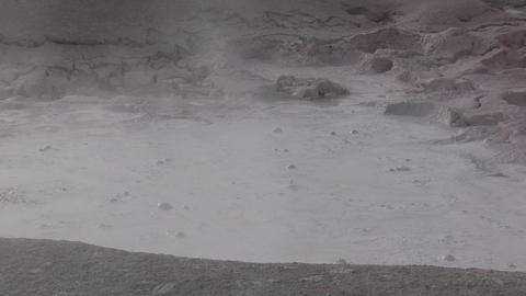A gray mud pit bubbles at Yellowstone National Park Stock Video Footage