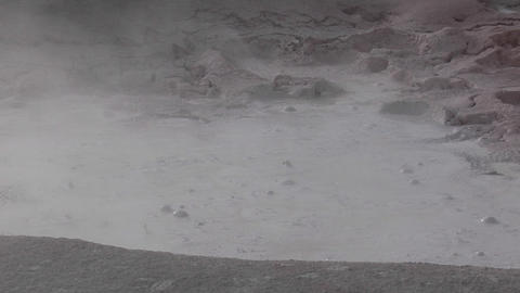 A gray mud pit bubbles at Yellowstone National Park Footage