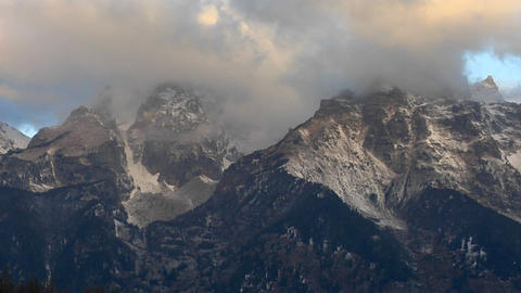 Clouds move across the Grand Teton mountain range Footage