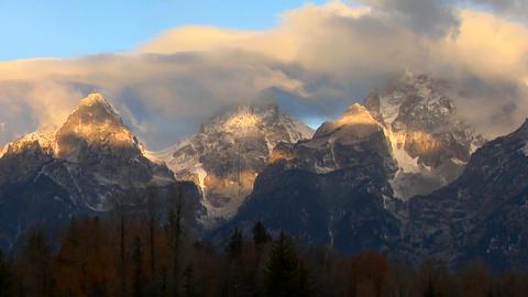 Clouds move across the Grand Teton mountain range Stock Video Footage