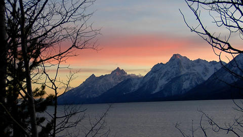 The Grand Teton Mountains stand at the end of a majestic lake Footage