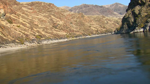 A jet boat moves up the Snake River in Idaho Stock Video Footage