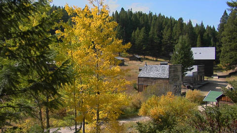 Abandoned buildings stand in an old western ghost town in... Stock Video Footage