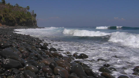 Ocean waves roll onto a rocky beach Stock Video Footage