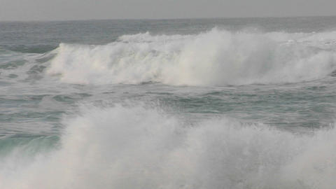 Waves crash and roll toward the shore Stock Video Footage