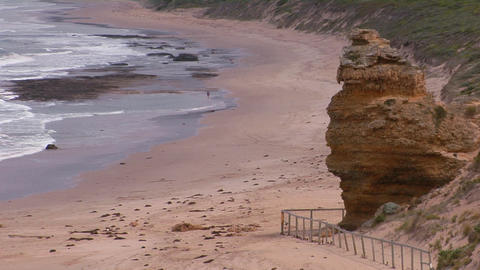 A person walks along a lonely, but scenic, beach Stock Video Footage