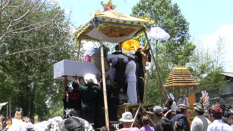 A body is loaded into the back of a platform in a Balinese cremation ceremony Footage