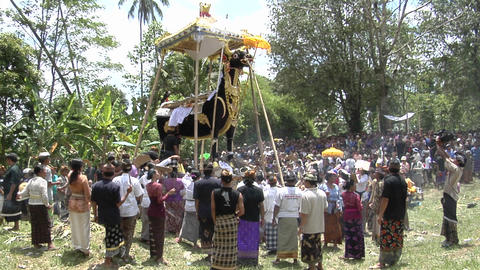 A large group of people gather at a cremation ceremony in Indonesia Footage