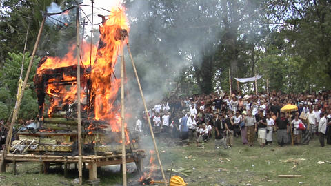 A funeral pyre burns at a cremation ceremony in Indonesia Footage