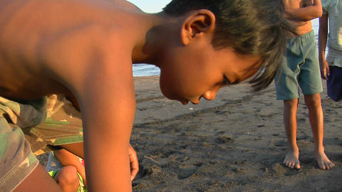 Bali children play a game, rolling bottle caps down the... Stock Video Footage