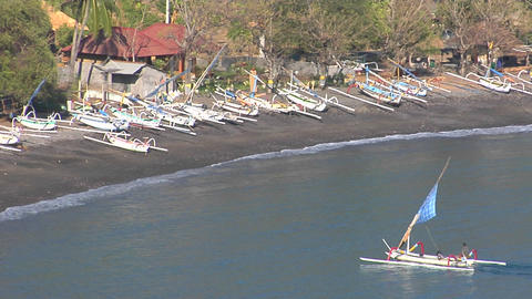 A catamaran style boat motors into a sandy beach Stock Video Footage