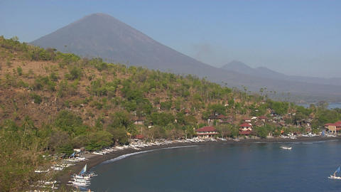 A white boat pulls into a harbor in Indonesia Stock Video Footage