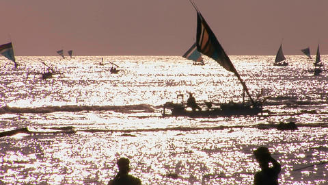 Numerous small boats sail on a shimmering sea Stock Video Footage