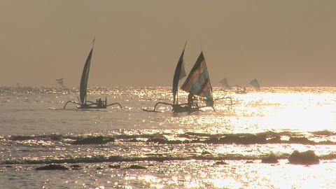 Sailboats coast across a shimmering sea Stock Video Footage