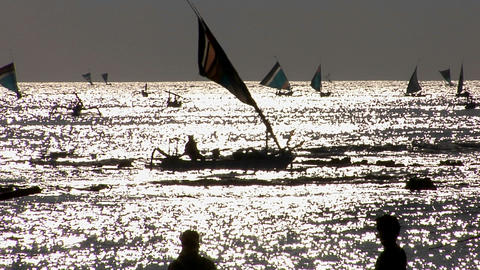 Sailboats move across the water Footage