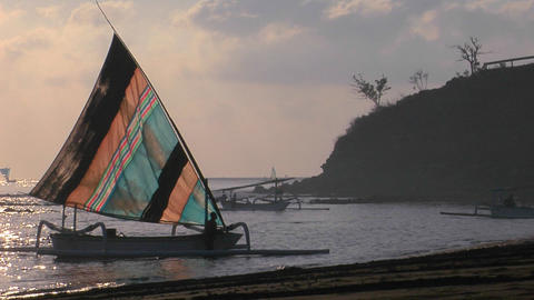 A catamaran-style fishing boat comes into shore Stock Video Footage