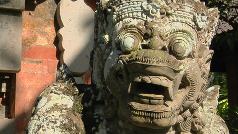 A Balinese God Stone Carving Guards A Temple stock footage