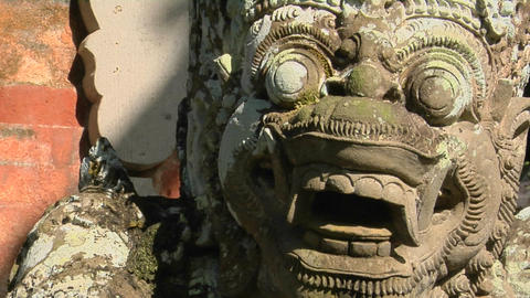 A Balinese God stone carving guards a temple Stock Video Footage