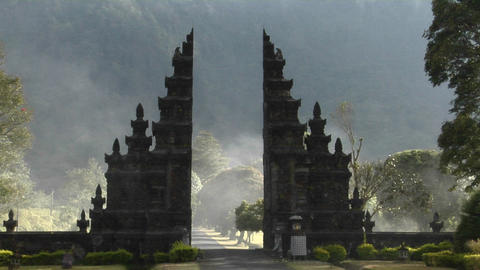 The fog drifts by a traditional Balinese temple gate in Bali, Indonesia Footage