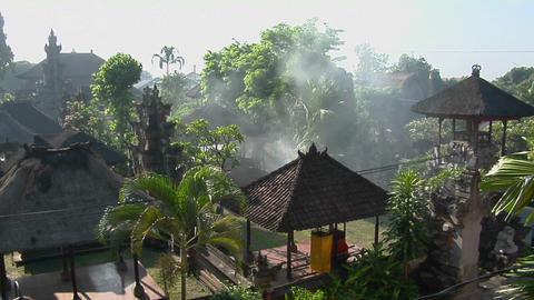 Smoke rises from the middle of the Balinese village in Indonesia Live Action