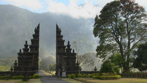 Fog drifts by a traditional Balinese temple gate in Bali, Indonesia Footage