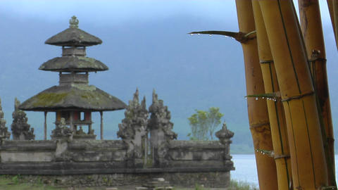 Bamboo drips with dew at the Ulun Danu temple on Lake... Stock Video Footage