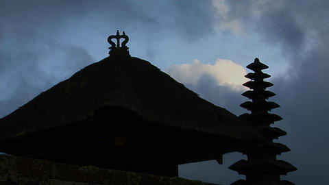 A Balinese temple stands in silhouette Stock Video Footage