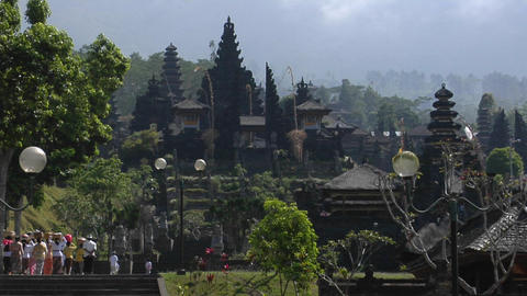 Visitors approach a Balinese temple complex Footage