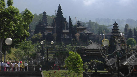 Visitors approach a Balinese temple complex Stock Video Footage