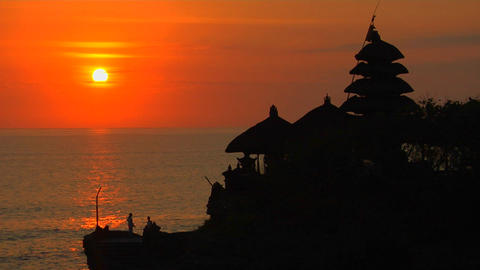 The Pura Tanah Lot Temple overlooks reflections in the ocean Footage