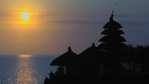The sun silhouettes The Pura Tanah Lot temple during... Stock Video Footage