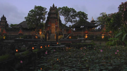 Lights flicker on the grounds of a temple in Bali, Indonesia Stock Video Footage