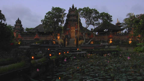 Lights flicker on the grounds of a temple in Bali, Indonesia Footage