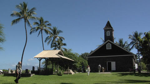 People arrive at a tropical church as the bell rings Stock Video Footage