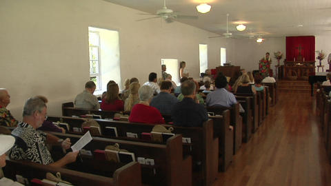 Pan across the interior of a small town church with many... Stock Video Footage