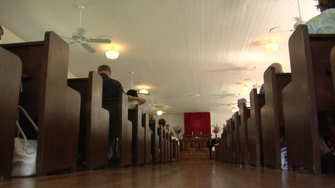 A low angle interior of a traditional church and pews Stock Video Footage
