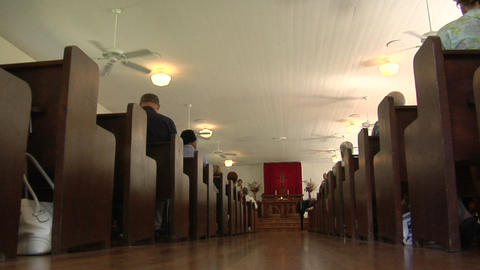 A low angle interior of a traditional church and pews Footage