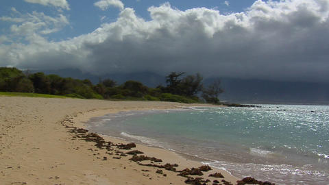 Waves roll into a beautiful white sand beach in Hawaii Stock Video Footage