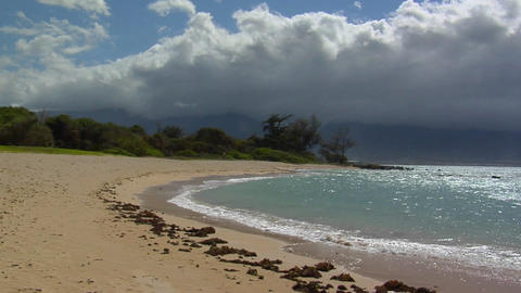 Waves roll into a beautiful white sand beach in Hawaii Footage