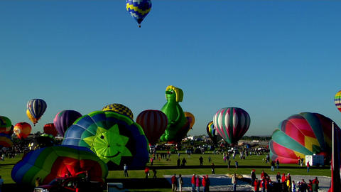 A timelapse shot of balloons filling and taking off at... Stock Video Footage