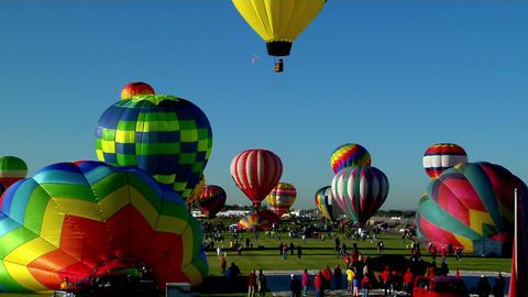 A timelapse shot of balloons filling and taking off at the Albuquerque Balloon Festival Footage