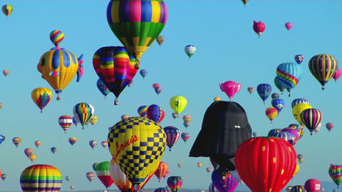 Balloons float across the sky at the Albuquerque balloon... Stock Video Footage