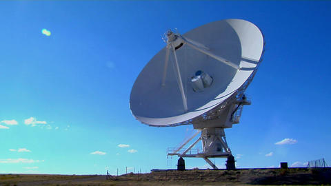 A time lapse of a huge satellite dish moving Stock Video Footage