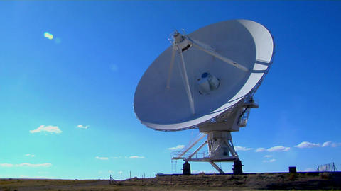 A time lapse of a huge satellite dish moving Footage