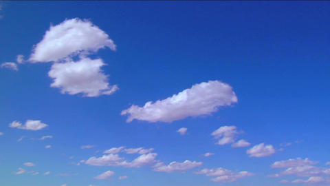 Time lapse clouds moving against a blue sky Stock Video Footage