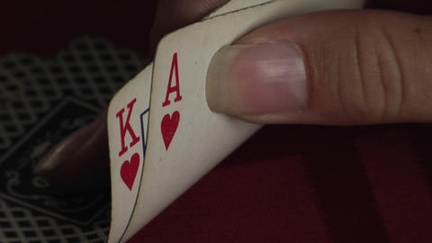 A hand turns up two playing cards to reveal a King and an... Stock Video Footage