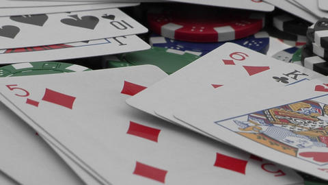 Playing cards and poker chips scattered over a card table Stock Video Footage