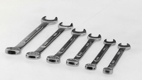 Six wrenches lie on a white surface in a precise order Footage