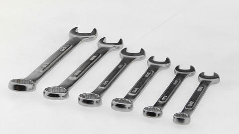 Six wrenches lie on a white surface in a precise order Stock Video Footage