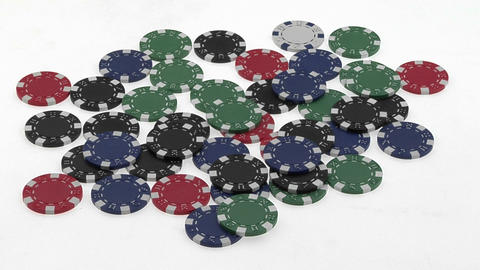 A poker player's hands gather a pile of poker chips Footage